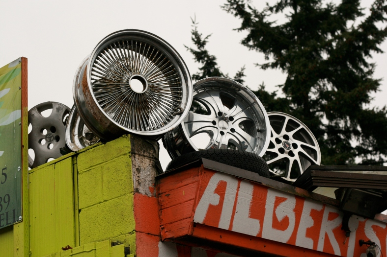 A closer look at the run down tire shop shows some beautiful art with these rims.