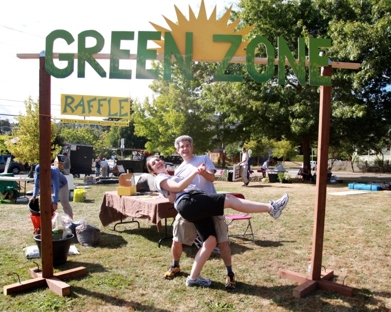 Delridge Day: It's a wrap! Tanya and Patrick at Delridge Day - below the sign Patrick created for the green zone.